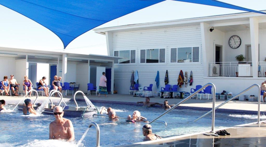 Relaxing in the hot springs pool at the Moree Artesian Aquatic Centre, NSW Australia