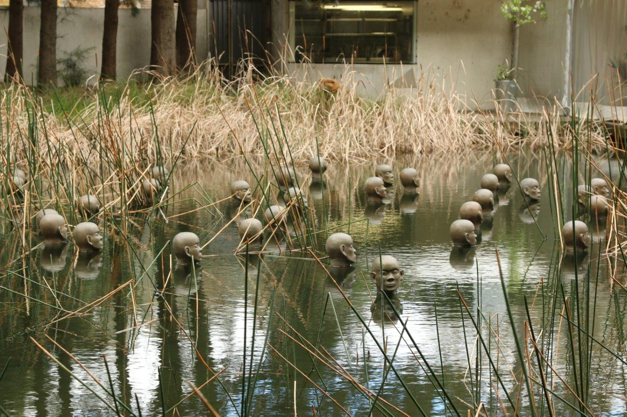 Creepy Heads in the Water in the Sculpture Garden at the National Gallery of Australia in Canberra