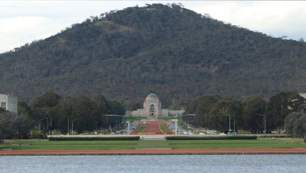 View of the Australian War Memorial across Lake Burley Griffin in Canberra Australia