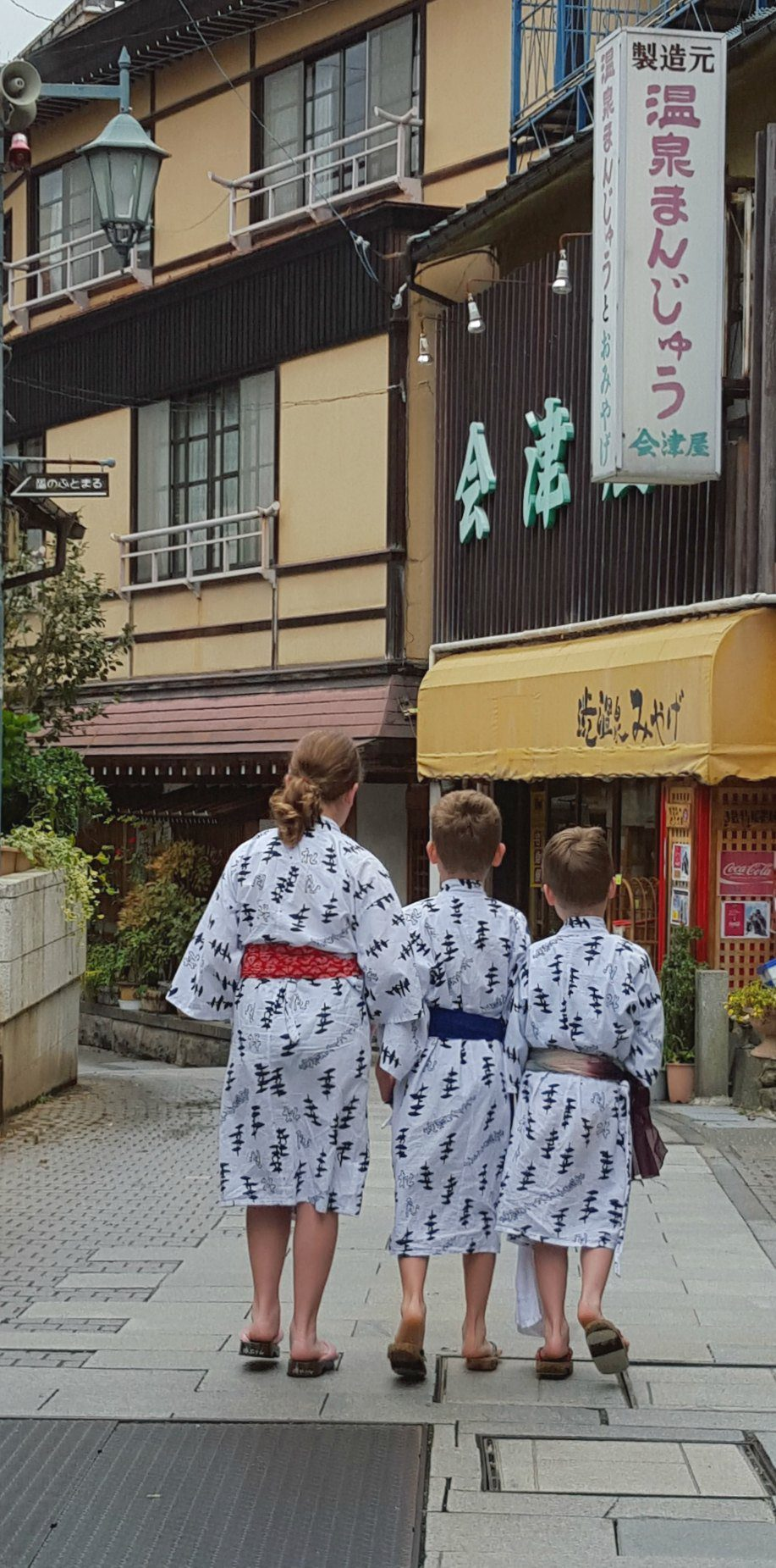 My children exploring Shibu Onsen in Japan, on our way to the onsen baths