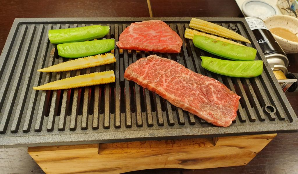 Cooking beef and vegetables on our teppan