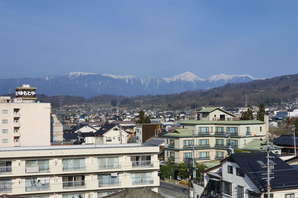 Our room view over the eastern edge of Matsumoto with mountains beyond
