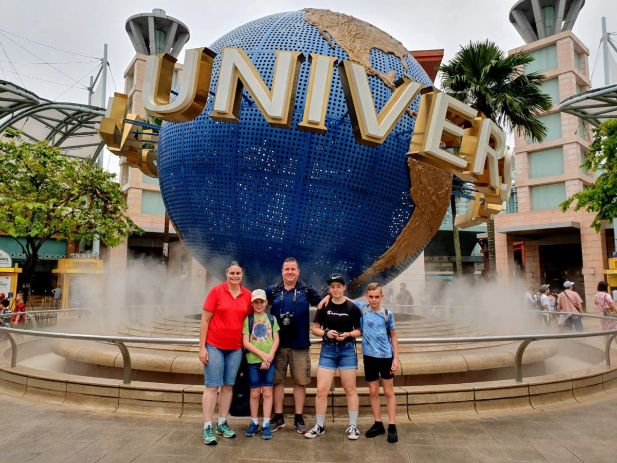 Our Family out the front of Universal Studios Singapore